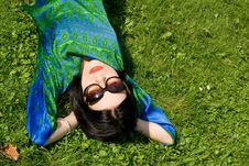 Girl Resting On Grass Stock Photos