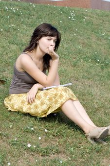 Free Girl Sitting On Grass Royalty Free Stock Image - 21274966