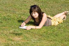 Free Girl Lying On Grass Royalty Free Stock Photo - 21275015