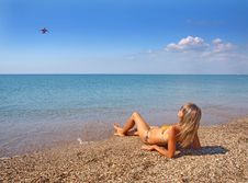 Free Beautiful Girl Relaxing On A Summer Beach Royalty Free Stock Image - 21278996