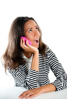 Free Teenage Girl On Pink Phone Listening At Desk Stock Photography - 21279382