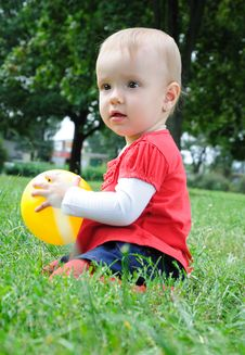 Free Cute Little Girl Playing With Yellow Ball Royalty Free Stock Photography - 21282917
