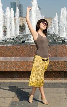 Girl Walking Near Fountain Royalty Free Stock Photos