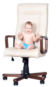 Baby Boy Sits In Office Chair On White Stock Photo