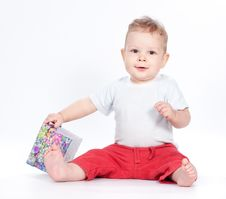 Free Baby Boy Opening Gift Box On White Royalty Free Stock Photography - 21288137