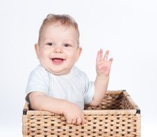 Baby Boy In Wicker Basket On White Royalty Free Stock Photo