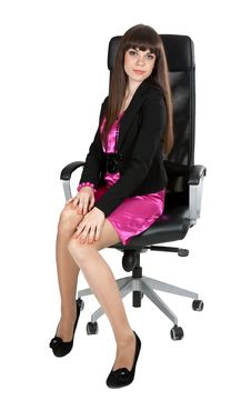 Beautiful Girl In Black Leather Chair Stock Images