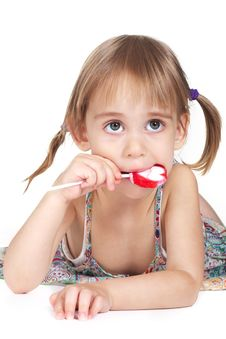 Free Little Girl Biting Red Heart-shaped Lollipop Stock Photography - 21289312
