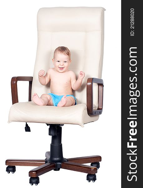 Baby boy sits in office chair on white