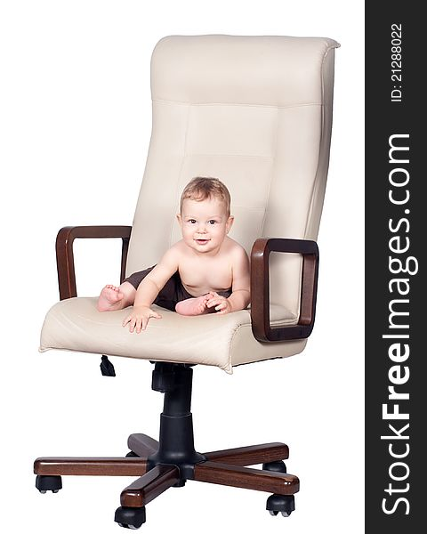 Baby boss sits in office chair on white