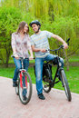 Free Happy Young Couple Riding Bicycles Stock Photo - 21297040