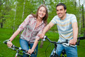 Free Happy Young Couple Riding Bicycles Stock Image - 21297041