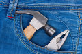 Free Hammer And Pliers In Pocket Jeans. Royalty Free Stock Photos - 21297378