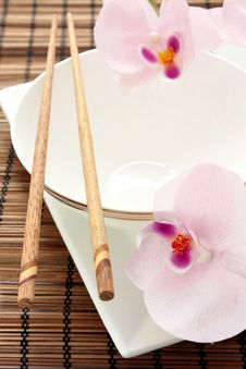 Free Asian Place Setting With Orchids Royalty Free Stock Photos - 21291428