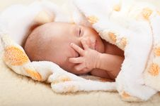 Free Baby Lying And Holding His Head. Royalty Free Stock Image - 21291856