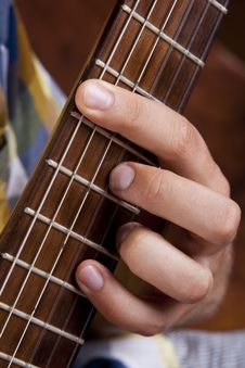 Free Really Great Shot Capturing Detail Of A Guitarist Stock Photo - 21293180
