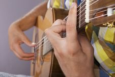 Free Really Great Shot Capturing Detail Of A Guitarist Royalty Free Stock Image - 21293226