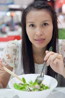 Woman Eating A Noodle Stock Photography