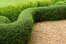 Abstract View  Green Lawn With Pebbles And Tiles Royalty Free Stock Photo