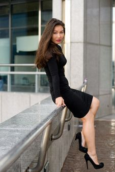 Sexy Girl In Black Dress Walking Royalty Free Stock Images