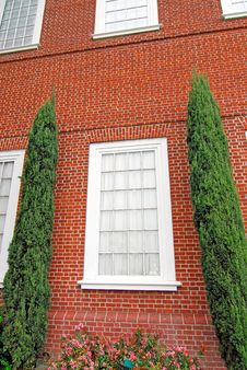 Free Window Flanked By Evergreens Royalty Free Stock Photo - 2131565