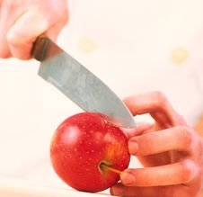 Free Cook Cuts An Apple Stock Photography - 2132812