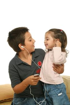 Free Children Enjoying A Mp4 Player Royalty Free Stock Photography - 2139797
