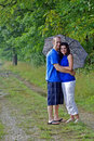 Free Couple Standing With Arms Around Each Other Stock Images - 21307004