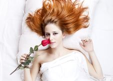 Free Fashion Red-haired Girl With Rose In The Bedroom. Stock Images - 21301634