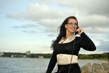 Free Girl With A Telephone Receiver In Hand Royalty Free Stock Photography - 21302037