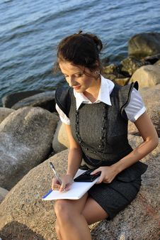 Free Beautiful Girl With A Notebook And A Calculato Stock Images - 21302064