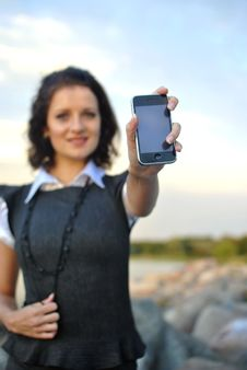 Lovely Young Woman Showing Mobile Phone Stock Image