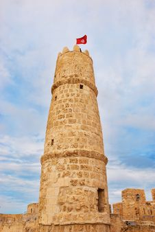 Tower Of Ribat In Monastir With Tunisian Flag Royalty Free Stock Photography