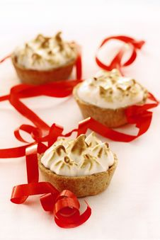 Free Mini Meringue Apple Pies On White With Red Ribbon Stock Image - 21305851