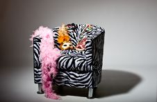 Free Bright Masquerade Masks On Retro Chair Stock Photos - 21305863