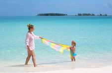 Free A Young Mother And A Baby On The Beach Royalty Free Stock Photography - 21306597