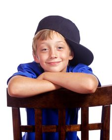 Young Boy Leaning With A Big Smile Royalty Free Stock Images