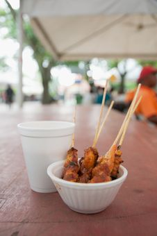 Free Chicken Satay In Peanut Gravy And A Soft Drink Stock Images - 21309474