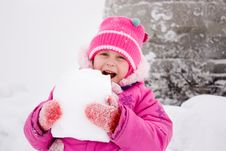 Free Girl Biting Piece Of Snow Royalty Free Stock Photo - 21309865
