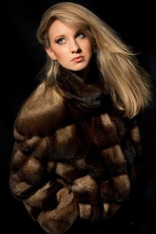Woman In Fur Jacket Royalty Free Stock Photography