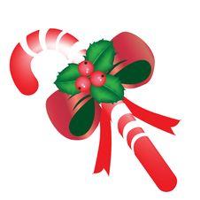 Free Christmas Candy With Mistletoe Stock Photo - 21317360