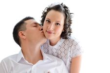 Woman With Man Near By Kissing Her Stock Images