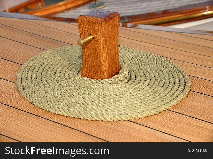 Coiled rope on teak deck