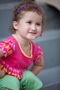 Free Cute Little Girl Smiling In Front Of The Building Royalty Free Stock Image - 21328326