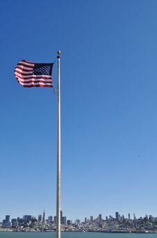 Free United States Flag Against San Francisco Skyline Royalty Free Stock Photo - 21327035