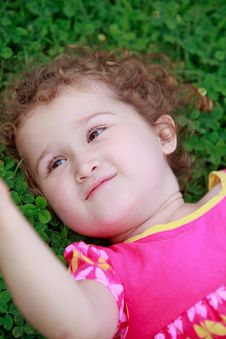 Free Little Adorable Girl Lying On Grass Royalty Free Stock Images - 21328389