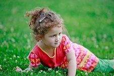 Free Little Adorable Girl Lying On Grass Stock Image - 21328451