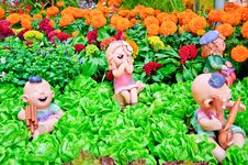 Free Happy Dolls In Garden Stock Images - 21333734