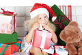 Free Little Girl In Santa Helper Hat With Gift Stock Photos - 21360153