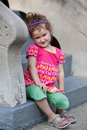 Free Cute Little Girl Smiling In Front Of The Building Stock Photo - 21365390